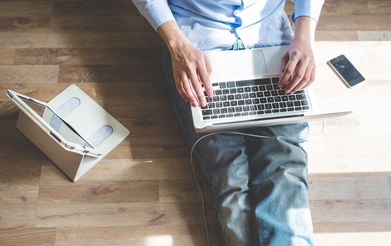 elegant business multitasking multimedia man using devices at home